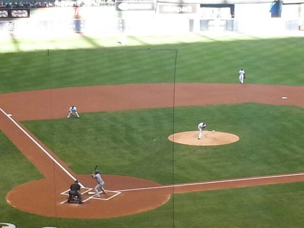 Hiram Burgos delivers his first career Major League pitch, a strike, in his debut on Saturday, April 20, 2013.